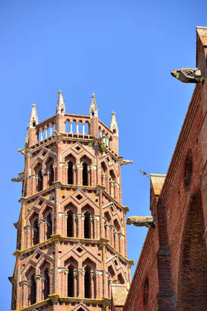 Bell tower of Les Jacobins church in Toulouse, France and gargoyles photo
