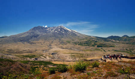 Wide angle view of Mount St Helens with people, Washington state photo