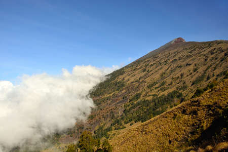 volcano slope: Final slope of Mount Rinjani volcano with cloud, Lombok, Indonesia