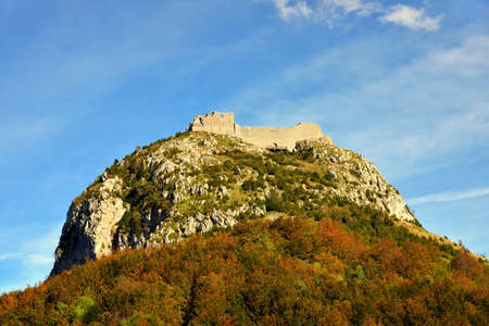 Montsegur cathar castle seen bellow in fall, Ariege, France
