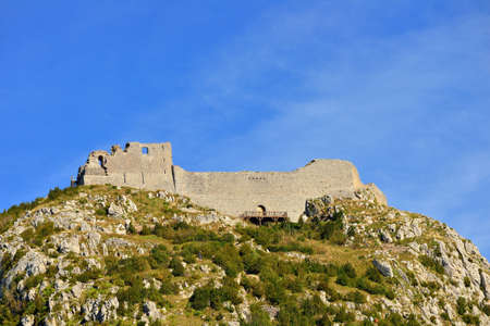 foothills: Montsegur cathar castle seen from bellow in fall, Ariege, France