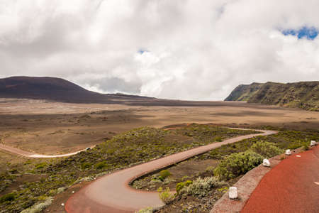switchback: Road switchback in la plaine des sables, a crater, la Reunion island Stock Photo