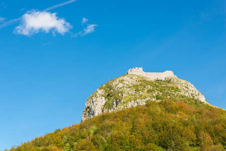 Montsegur cathar castle seen bellow in fall, Ariege, France photo