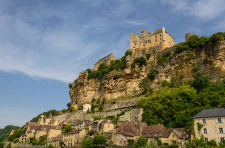 troglodyte: Beynac-et-Cazenac old castle and city on a cliff, Dordogne and Perigord, France Stock Photo
