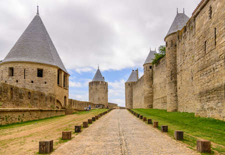 fortification: Large cobblestone street and fortification in Carcassonne medieval city, France