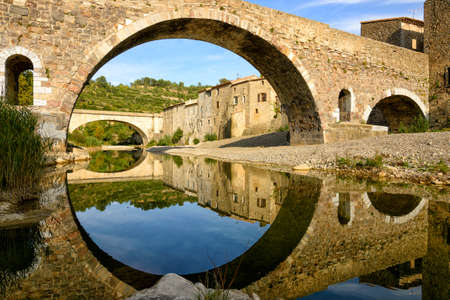 symmetry: Reflection and symmetry with a medieval bridge in Lagrasse, France
