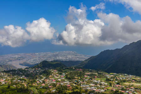 Indian ocean, coastline and village from above, la Reunion