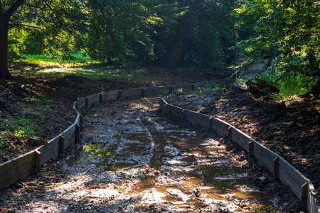 Dredged water canal in the park in the castle garden in Kromeriz in the Czech Republic. Stock Photo