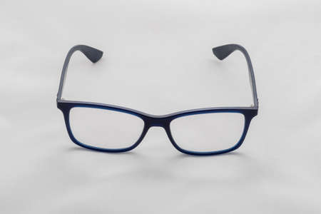 Blue teardrop-shaped glasses. Photo on a white background.