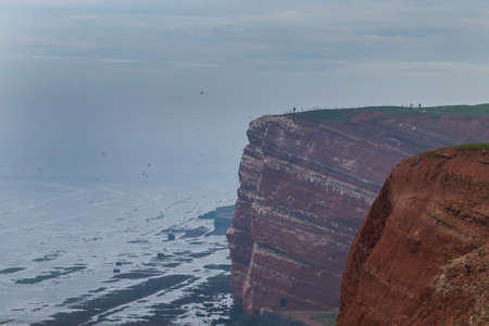Sunset on Helgoland island in Germany on the top of Long Anna. It is getting dark and there is fog Standard-Bild