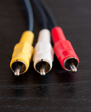 Close up of red, white and yellow RCA cables photo