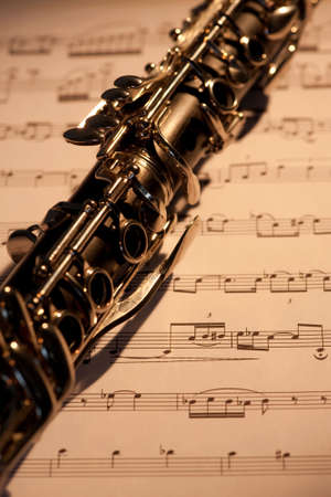 A close up of a clarinet with sheet music under it Stock Photo - 4371129