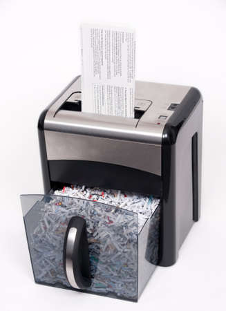 A paper shredder with a confidential document about to be shredded Stock Photo - 4398536