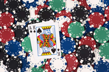 big slick: Ace and king on a pile of poker chips