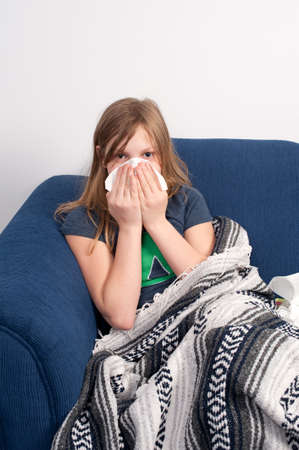 A young girl that is sick with cold or flu