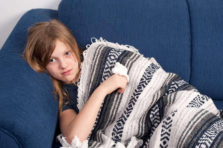 A young girl that is sick with cold or flu photo
