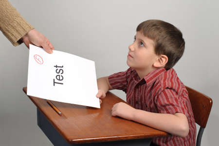 failing: A boy receiving a failing test score
