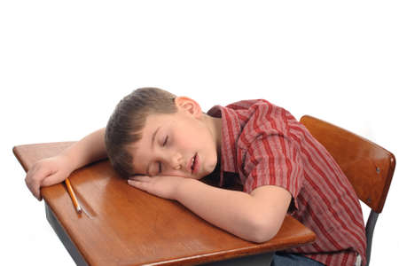 A school boy resting at his desk Stock Photo - 4474262