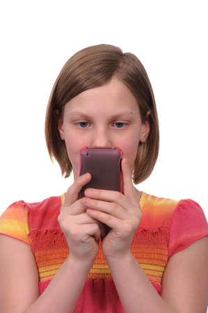 pre adolescents: A young girl texting messages on a smart phone