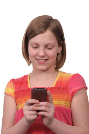 A young girl texting messages on a smart phone Stock Photo - 4704198