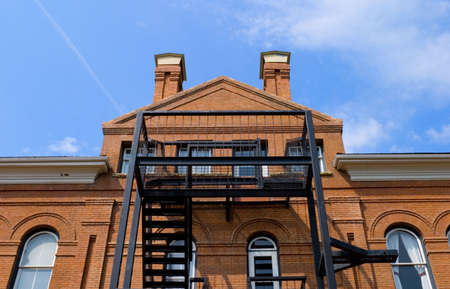 A fire escape on an old brick building Stock Photo - 5464047