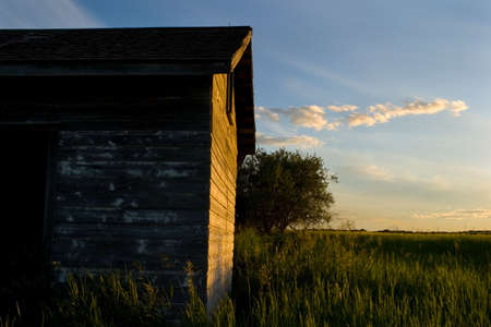 An old weathered building with the sun shining on it Stock Photo - 6097731