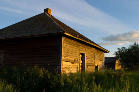 An old weathered building with the sun shining on it Stock Photo - 6097728