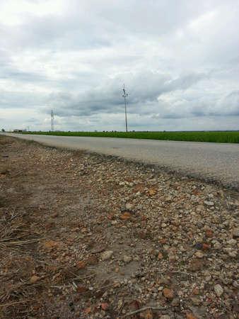 beside: Roadside view beside paddy field Stock Photo