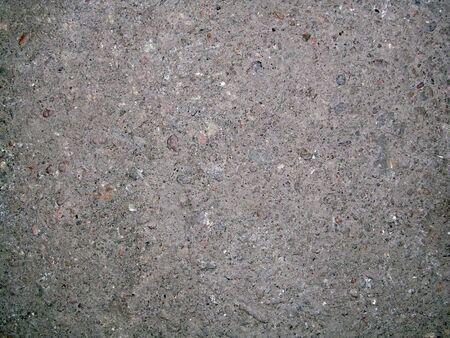 Texture of gray stony asphalt. Asphalt road. Imagens