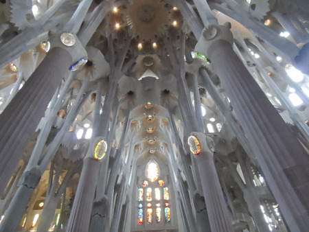 stained glass windows: inside famous church Sagrada Familia Barcelona Spain, viewing stained glass windows and ceiling structure