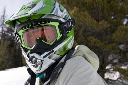woman snowmachine rider suited up and ready for the trails Banco de Imagens