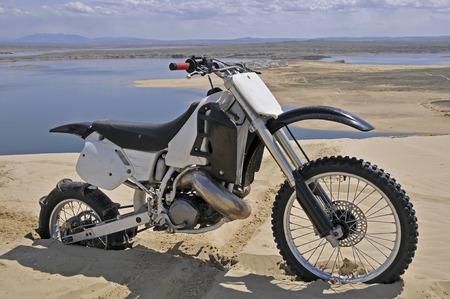 road bike: dirt bike with paddle tire burried in sand dune
