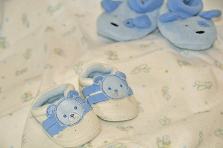 2 pair of baby blue infant shoes photo