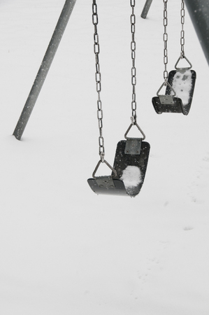 contradiction: Snow covered swingset