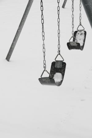 Snow covered swingset