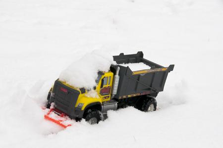 Toy Truck pushing snow Banco de Imagens