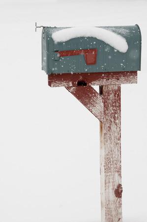 deep freeze: Mailbox burried in deep snow -rustic