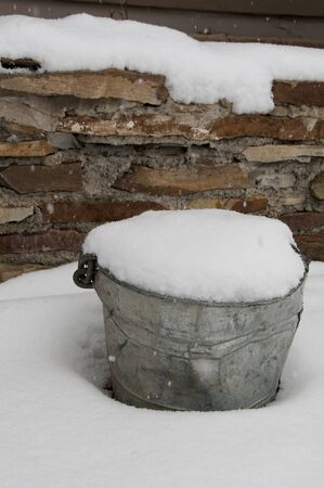 burried: bucket with snow