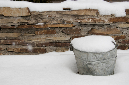 burried: metal bucket filled with snowfall