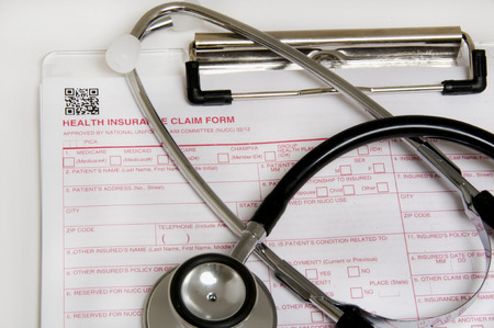 Insurance claim form and stethescope representing the healthcare industry Banco de Imagens