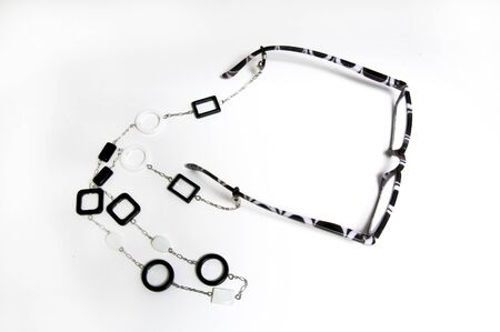 White and black eyewear reader and holder for near activities