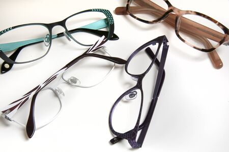 Selection of frames for eye wear purchases at optometrist or vision specialist Banco de Imagens