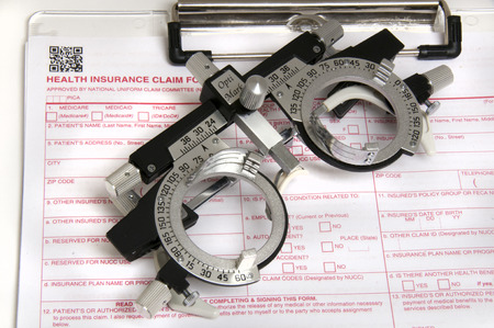 Insurance claim form and trial frame for testing vision