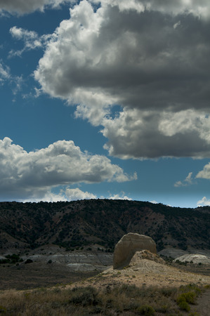 sagebrush: Sagebrush and Sandstone, Wind blown summer day, with fluffy bright clouds passing overhead Stock Photo