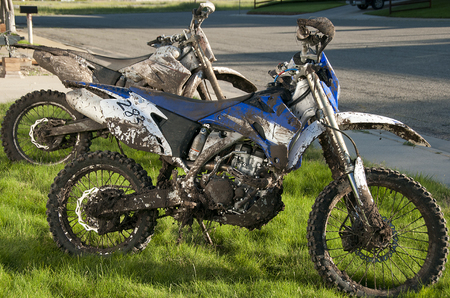 dirt bikes: Dirty Dirt Bikes after race in mud conditions, need washed
