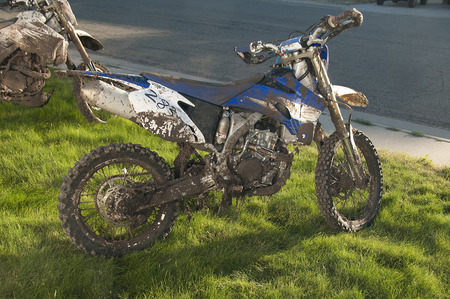 dirt bikes: Dirty Dirt Bikes after race in mud conditions Stock Photo