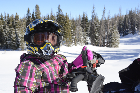 Young girl in snowmobiling helmet and goggles Banco de Imagens