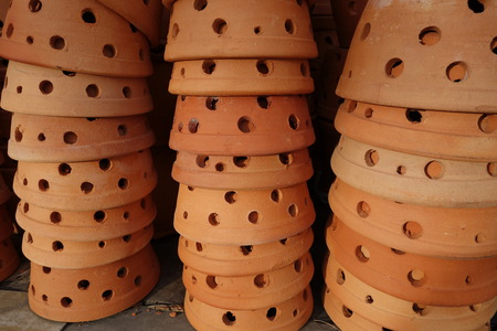 pot hole: Stack of clay flower pots