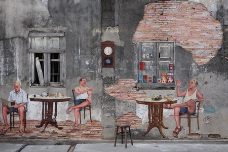kopitiam: SONGKHLA, THAILAND - MAY 15, 2015: An old concrete wall of the former tea shop named Fu Chao built in 1919 in old town district was dressed up with a mural artwork to depict the inside atmosphere. Editorial