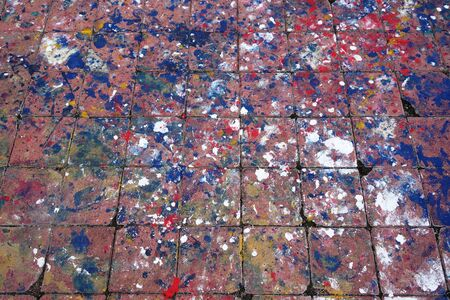 splashed: Abstract background of splashed paint on brick floor tiles
